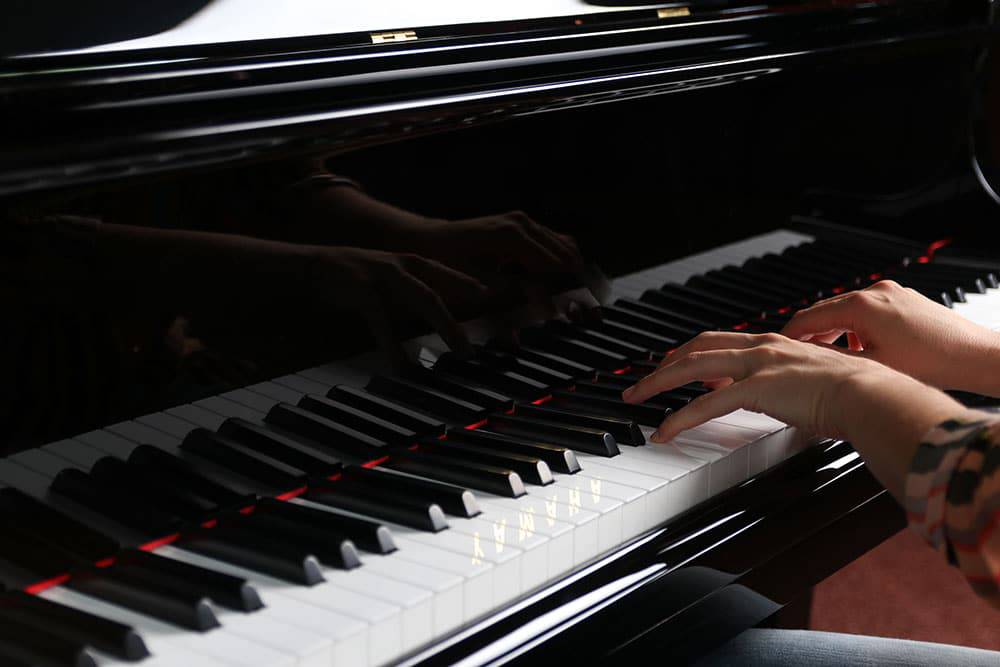 Close up of hands playing the piano