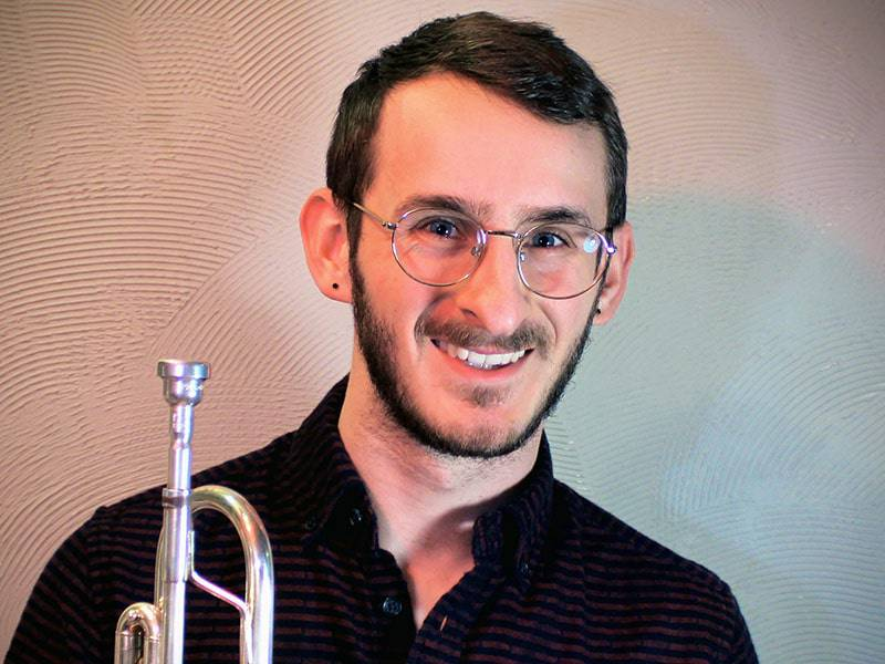 Music House instructor David Thal and his trumpet