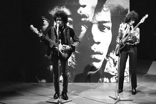 Jimi Hendrix performing on stage with Noel Redding