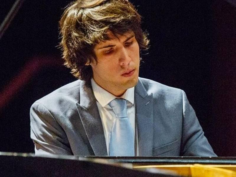 Instructor Manuel Vizurraga playing piano