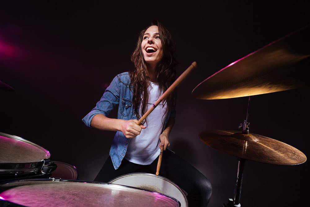 Woman playing drums at concert