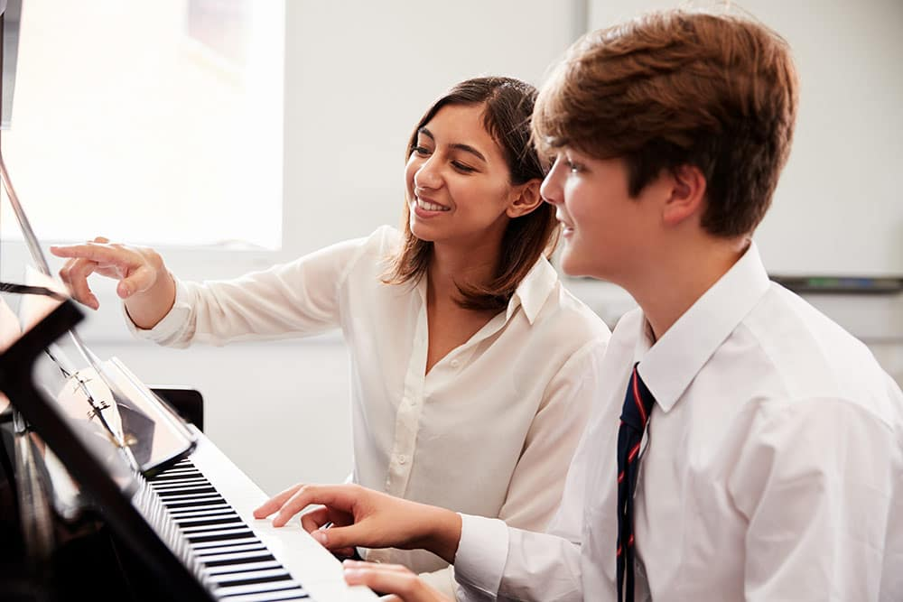 Young boy with instructor having private music lessons