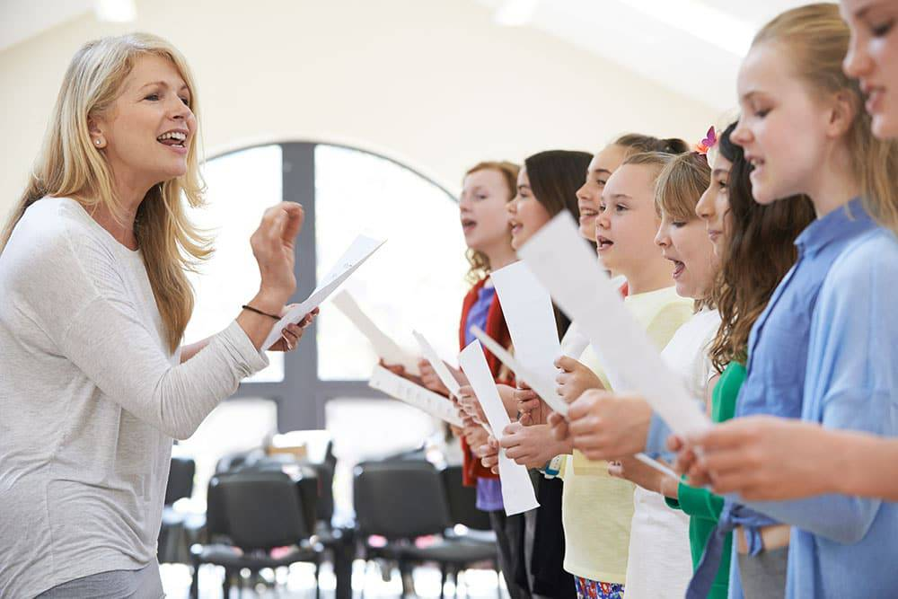 Young kids with teacher taking voice lessons
