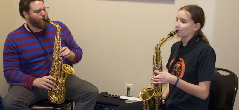 Russell and sax student