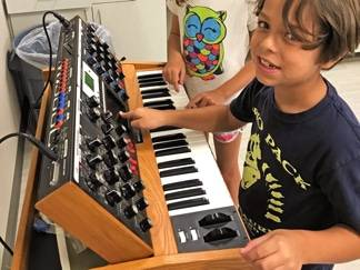 Student with synthesizer